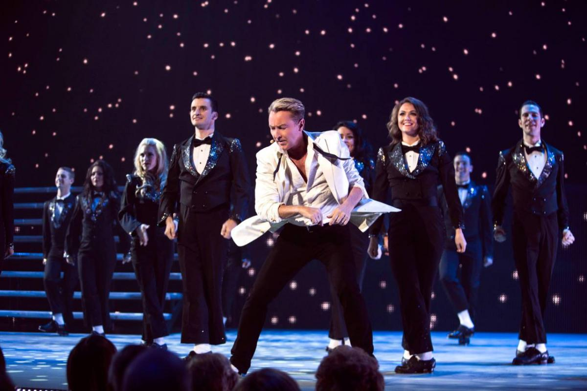 Michael Flatley dances with an Irish dance group in Lord of the Dance Dangerous Games