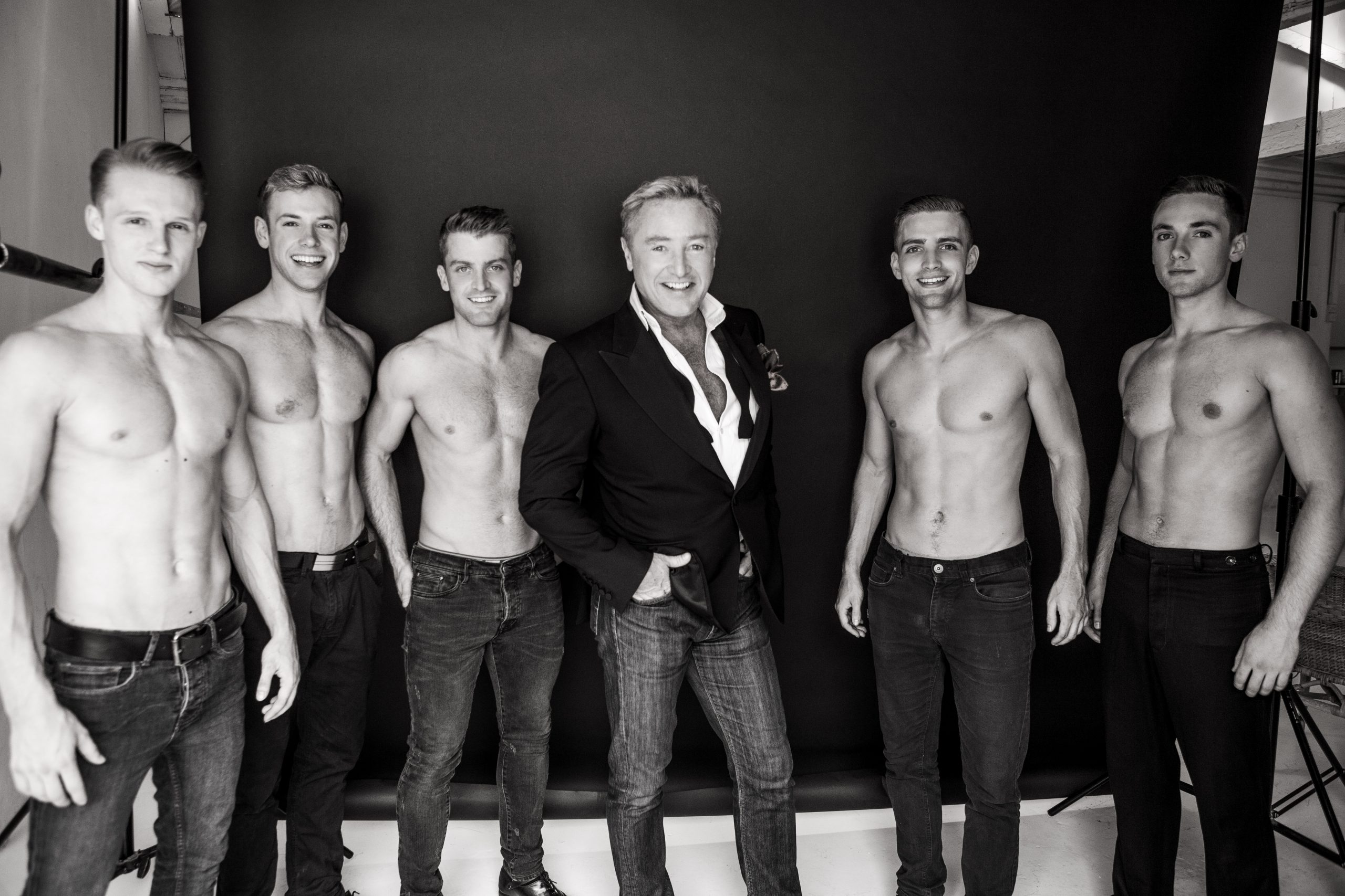 Michael Flatley is flanked by Lord of the Dance Dangerous games Irish dancers